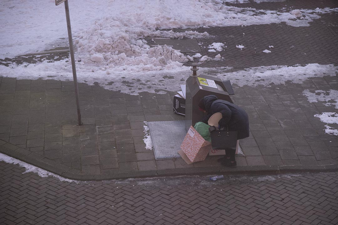 Bin with woman and boxes