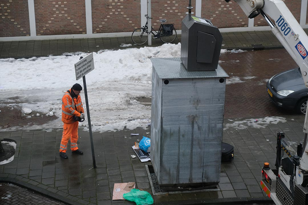 Bin being emptyed in the snow