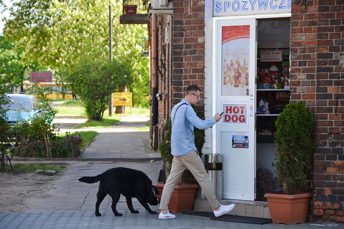 Man walking into shop in Praga in Warsaw