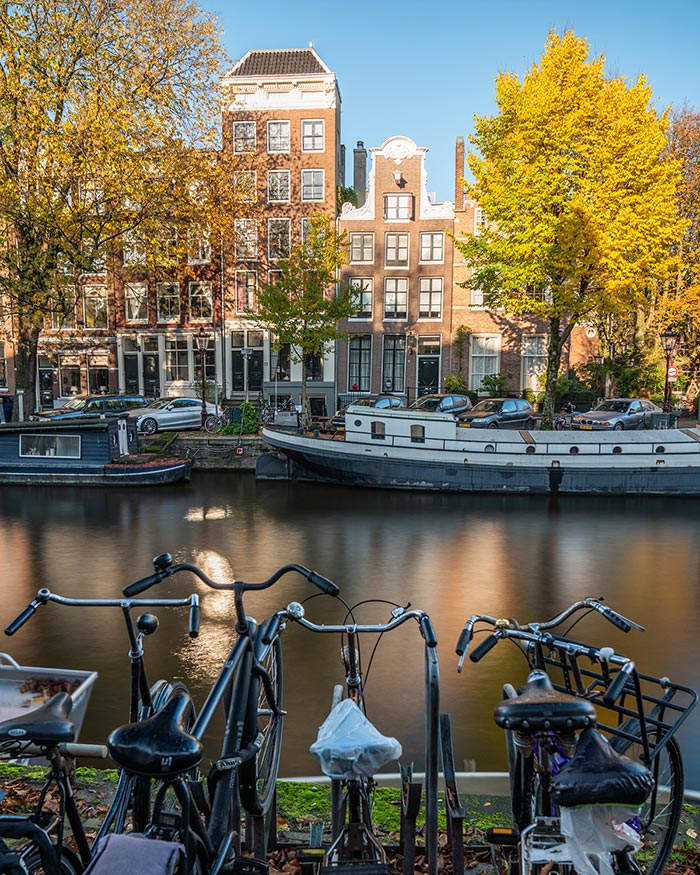 Amsterdam canals houses with bikes in foreground