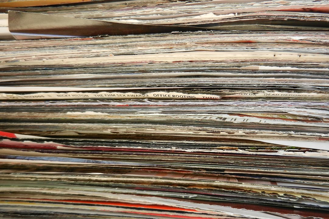 Stack of pages torn from magazines